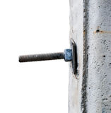 Macro of a bolt sticking through a cement pole Stock Image