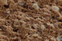 Macro of a bread with seeds, slice. Macro from slice of a bread with seeds royalty free stock photo