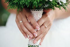 Macro bride holding a bouquet. Bride holding a bouquet rustic macro hands Stock Photo