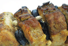 Macro of broiled meat with prunes Royalty Free Stock Photos