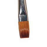 Macro brush painting isolated on white Royalty Free Stock Photo