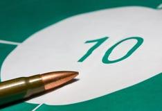 Macro of bullet on bullseye Stock Photos
