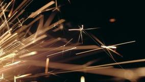 Macro burning Sparkler. Close-up shot of a burning Sparkler on black background stock footage