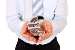 Macro business man holding a silver metal euro sign Royalty Free Stock Images
