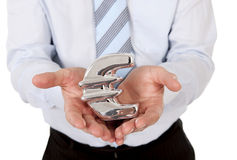 Macro businessman holding a silver mental euro sign Royalty Free Stock Photos