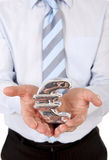 Macro businessman holding a silver mental euro sign Royalty Free Stock Photography