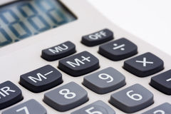 Macro of calculator. Macro of a calculator on white Royalty Free Stock Photo