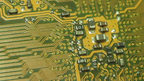 Macro Camera Dolly across diagonal printed circuits:start from soldered circuit 'nipples' then move to circuit cluster;returnShot stock footage