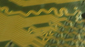 Macro Camera Dolly diagonally down computer circuit board, then return to 1st position. Shot with special macro lenses,this shot stock video