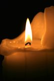 Macro Candle. A macro shot of a burning candle in a darkened room Royalty Free Stock Photos