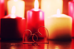 Macro candle light with heart shape Royalty Free Stock Images