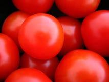 Macro Cherry Tomatoes. Macro photograph of ripe fresh cherry tomatoes Stock Image