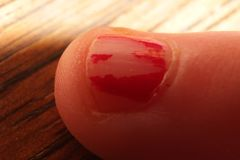 Macro Child finger nail with chipped polish royalty free stock photo