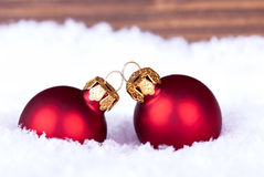 Macro of Christmas Balls in the Snow Royalty Free Stock Image