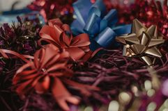 Christmas red and golden bows. Set of holiday presents decoration. Macro of the christmas red and golden bows. Set of holiday presents decoration Royalty Free Stock Images