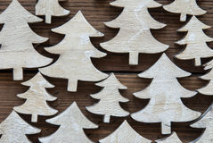 Macro Of Christmas Trees On Wooden Background Stock Photos