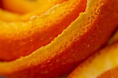 Art image with a peel mandarin. Closeup and texture with a peel an orange. A concept for a decor food. Macro citrus fruit peel. Background with peel a tangerine stock photography