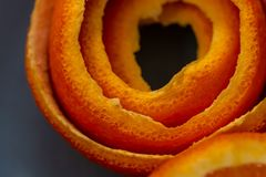 Macro citrus fruit peel. Dark Background with peel a tangerine. Art image with a peel mandarin. stock photo