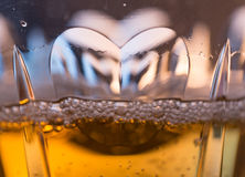 Macro close shot of heart in champagne glass Stock Image