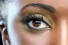 Macro close up of african eye with make up. Extreme close up of african female eye with professional make up royalty free stock images