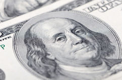 Macro close up of Ben Franklin's face on the US $100 dollar bill stock photos