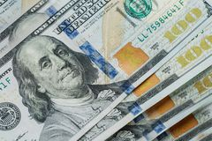 Macro close up of Ben Franklin`s face on the US 100 dollar stock images