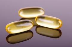 Macro close up of capsules of Omega 3 fatty acids for well-being. Macro close up of Omega 3 vitamin  fatty acids capsules for healthy lifestyle stock photos