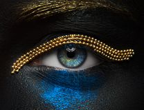Macro and close-up creative make-up theme: beautiful female eyes stock photography