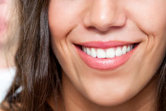 Macro close up of female smile Stock Photos
