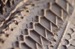 Macro Close Up of Fresh Motorcycle Tread Pattern on Muddy Trail Royalty Free Stock Images