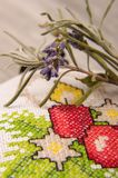 Macro close up of levande blooms and branch and cross stiched ba. Christmas ornaments cross-stitched bag filled with levander blooms Stock Photos