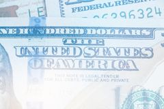 Macro close up Light toning of Ben Franklin`s face on the US 100 dollar bill. Macro close up of Ben Franklin`s face on the US 100 dollar bill Royalty Free Stock Photography