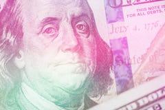 Macro close up Light toning of Ben Franklin`s face on the US 100 dollar bill. Macro close up of Ben Franklin`s face on the US 100 dollar bill Royalty Free Stock Image