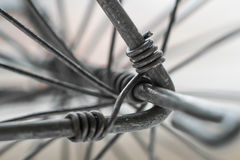 Macro close-up of metal wire twisting for wheel. Wheel construction made of twisting wire rods Royalty Free Stock Image