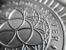 Macro close up of a pure Silver Bullion coin. Used as a means of exchange and a store of value stock images