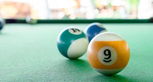 Free Macro Close Up Shot Of A Nine Ball Billiard With Some Blurry Billiard Ball In The Background Royalty Free Stock Image - 134601016