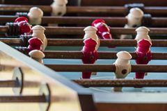 Macro close up shot of a old antique rusty football soccer table. With white and red player stock photos