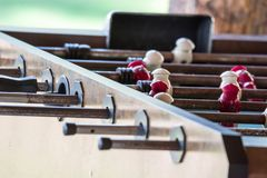 Macro close up shot of a old antique rusty football soccer table. With white and red player stock photography