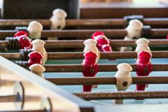 Macro close up shot of a old antique rusty football soccer table. With white and red player royalty free stock photos