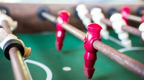 Macro close up shot of a old rusty football soccer table. Showing red, white and green royalty free stock photos