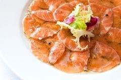 Macro close up of smoked salmon carpaccio. Royalty Free Stock Photos