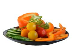 A close-up photo of some fresh vegetables capsicum, tomato and cucumbers, an excellent healthy snack or a side dish. Macro; close-up; structure and colour of stock photography