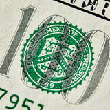 Macro close up of the US 100 dollar bill Stock Images