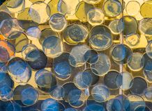 Macro closeup of a beautiful glass art work, round circle shapes pattern, modern architecture background. A macro closeup of a beautiful glass art work, round royalty free stock image