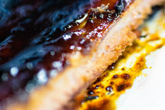 Macro closeup of Cooked Ribs Royalty Free Stock Photography