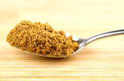 Macro closeup of crushed cumin seeds in spoonful Royalty Free Stock Images