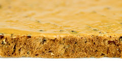 Macro closeup of edge of peanut butter toast Stock Image