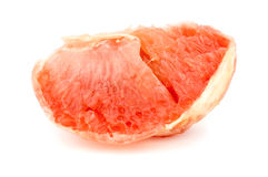 Macro closeup of juicy ripe slice of grapefruit Stock Photos