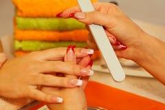 Macro closeup of nail polisher at work Stock Photography