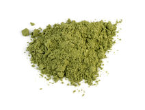 Macro closeup of organic wheatgrass powder isolated Stock Images